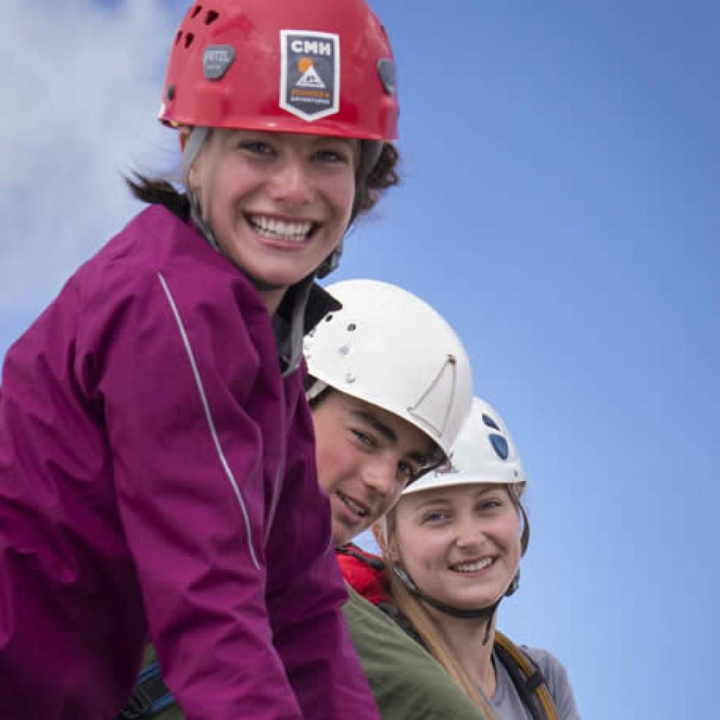 Shannon Ryan, Koeye McAllister, Micaela Mauthner on summit of Eastpost.© Pat Morrow 2013