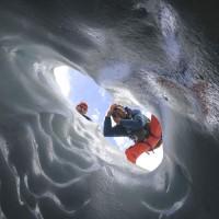 Herb Weller and Pat explore the sculpted crevasses of Robson glacier © Max Darrah