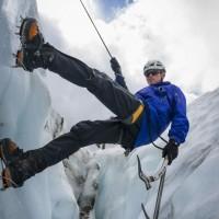 Graham Kinley ice climbing in the rain. © Pat Morrow