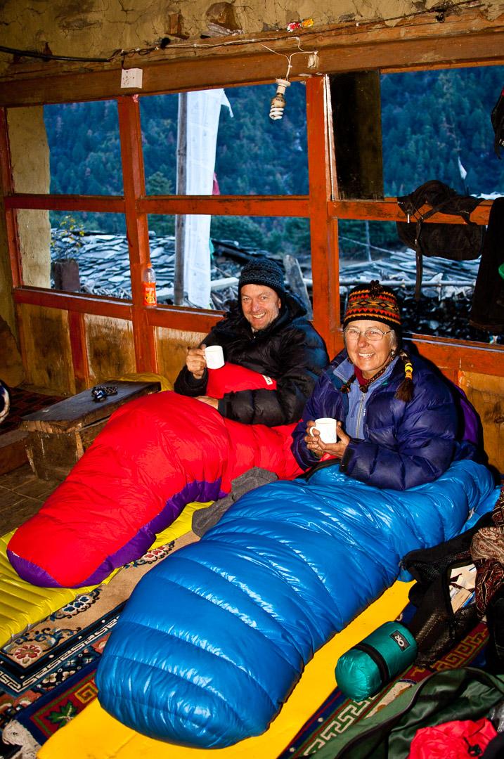 Pat & Baiba in breezy homestay (-10C), Tsum Valley trek, Chhokang Paro village, Manaslu area. Nepal Dec 2010
