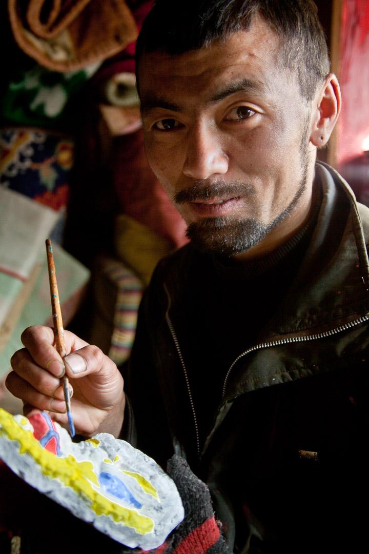 Tsum Valley trek, Dec 2010. Lama Nawang Thinley paints figurines for monastery, Nile