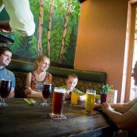 Uldis, Dace and Madars quaff local brews in roadside tavern near Sigulda