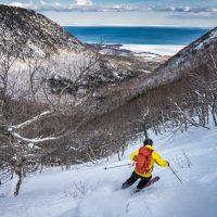 Gregor Wilson drops into French Gulch, Cape North, Cape Breton Island, Nova Scotia adventure ski shoot for Ski Canada magazine.