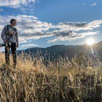 Marco Delasalle on bird hunt with camera, Wilmer Wetlands, BC