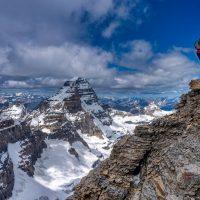 Ascent of sw face route on Mt Eon 3305m, Mt Assiniboine behind, Assiniboine Provincial Park, BC with Mike Baker.